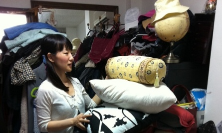 """This undated photo provided by Ten Speed Press shows Marie Kondo working at a client's home to clear away everything that is unneeded and fails to """"spark joy,"""" in Tokyo, Japan. Kondo, whose method of decluttering is known as the KonMari Method, is the author of the book, """"The Life - Changing Magic of Tidying Up."""" (AP Photo/Ten Speed Press)"""